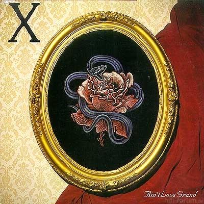 X - Ain't Love Grand 1985.jpg